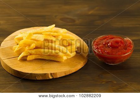 French  Fries With Fresh Ketchup An Old Cutting Board