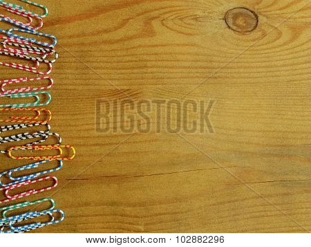 Colorful Paper Clips On Wood Background