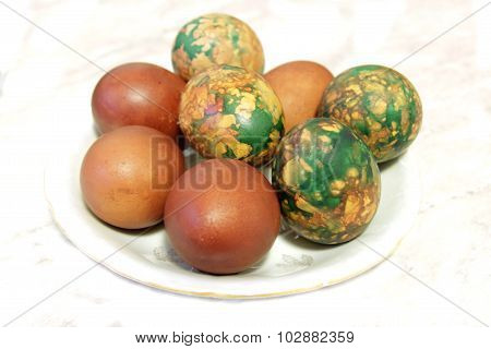 Colorful Easter Eggs On White Plate Placed By Heap