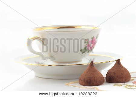 Tea Cup And Chocolates
