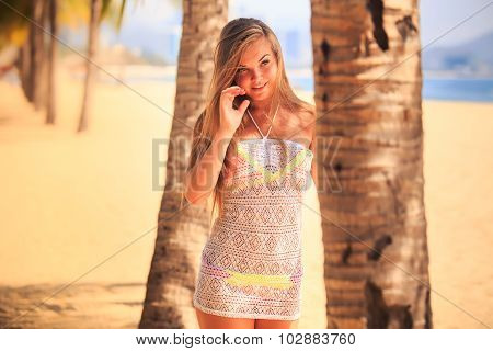 Blonde Girl In Lace Closeup Stands At Palm On Beach