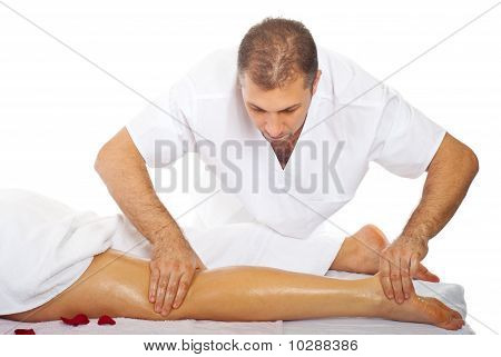 Masseur Massaging Woman's Leg