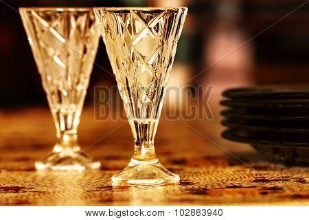 Two Vodka Shot Glasses On Table