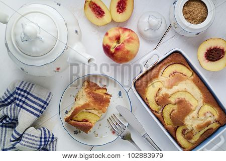 Diet Yogurt Sponge Cake With Peaches On Table. Homebaked Food.