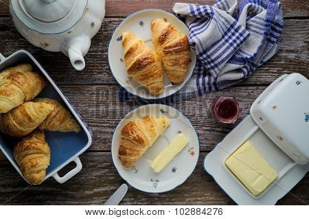 Home-baked Puff Pastry Butter Croissants With Marmalade In Rustic Setting