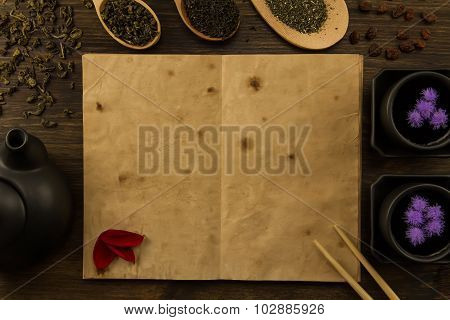 Black Teapot, Two Cups, Tea Collection, Flowers, Old Blank Open Book On Wooden Background. Menu, Rec