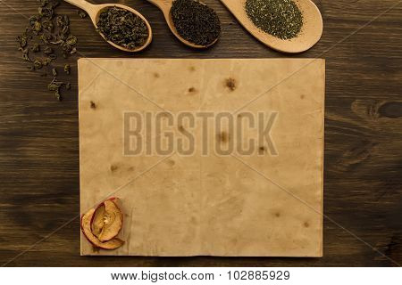 Black, Oolong In A Spoon, Dried Apples On The Old Blank Open Book On Wooden Background. Menu, Recipe