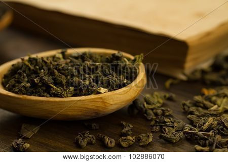 Oolong Tea In Wooden Spoon On A Background Of Old Vintage Books. Menu, Recipe