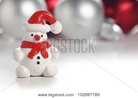 Snowman with Santa hat. Christmas greeting card with copy space