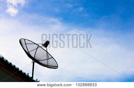 Satellite Dish And Blue Sky Background.