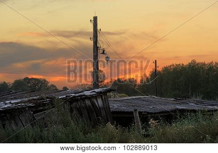 Old Wooden Shed And Pole In The Country In Sunset