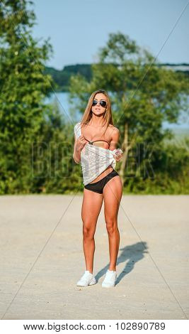 Sporty Fit Girl Outdoor On The Beach