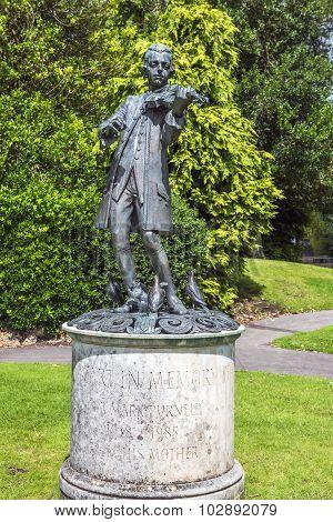 Mozart Statue In Parade Gardens. In Bath, Somerset, England