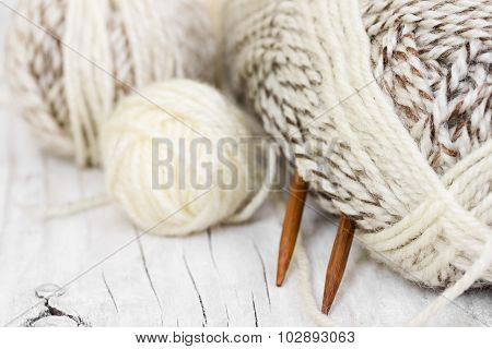 Skeins Of Wool Yarn And Knitting Needles