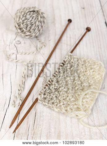 Knitting Pattern Of Yarn On Wooden Needles