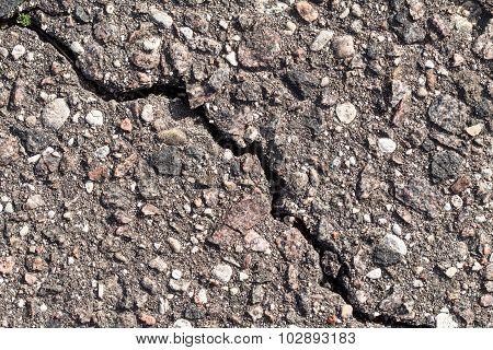Old Worn And Cracked Asphalt