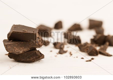 Broken Chocolate Bar On Wooden Background, Close-up