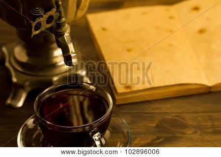Tea Still Life With Samovar On Wooden Background. Empty Open An Old Vintage Book. Russia Autumn.