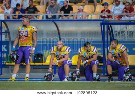 VIENNA, AUSTRIA - JUNE 22, 2014: DL Harald Zipfelmayer (#99 Vikings) and his team mates stand on the sideline during the game.