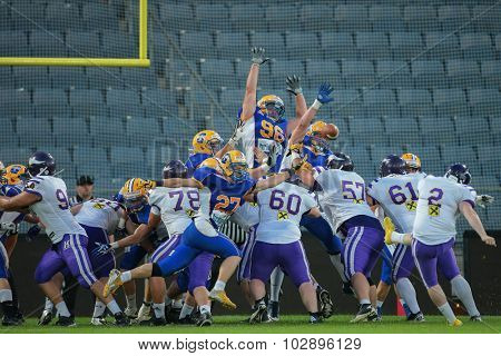 GRAZ, AUSTRIA - JUNE 27, 2014: K Christopher Kappel (#2 Vikings) kicks a PAT during an Austrian football league game.