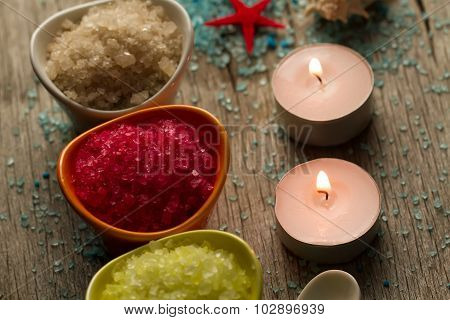 Colorful Sea Salts And Seashells For The Bathroom On Wooden Background. Candles, Spa, Aromatherapy.