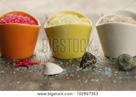 Colorful Sea Salts And Seashells For The Bathroom On Wooden Background. Spa, Aromatherapy.