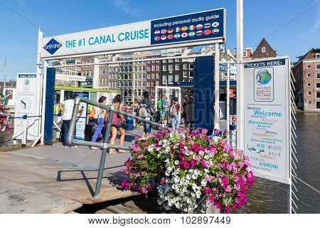 Tourists Buying Tickets At Departure Place Of Amsterdam Canal Cruises