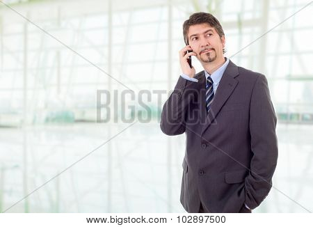 young businessman on the phone, at the office
