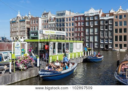 Motor Boat With Tourists At A Departure Place Of Amsterdam Canal Cruises