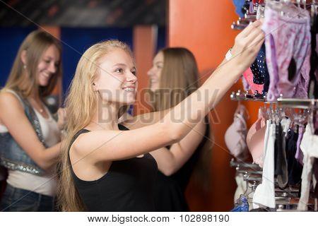 Young Women Choosing Lingerie