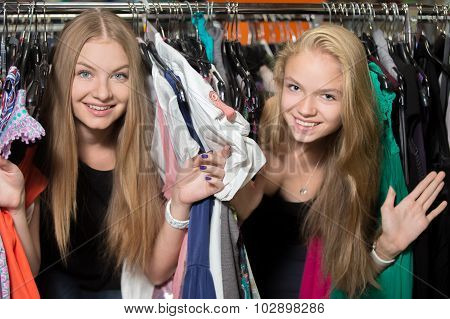 Playful Girlfriends In Garments Shop