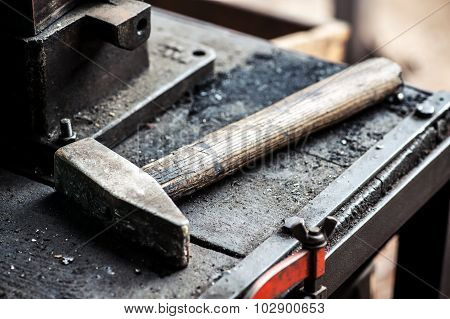 Heavy Iron Mallet Or Hammer On A Workbench