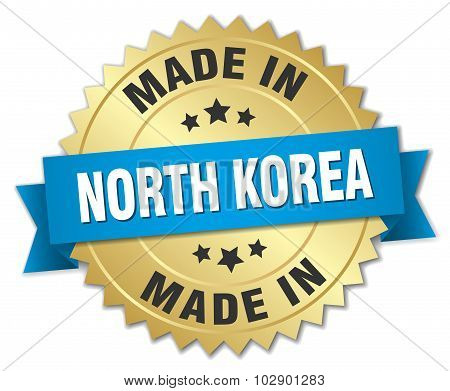 Made In North Korea Gold Badge With Blue Ribbon
