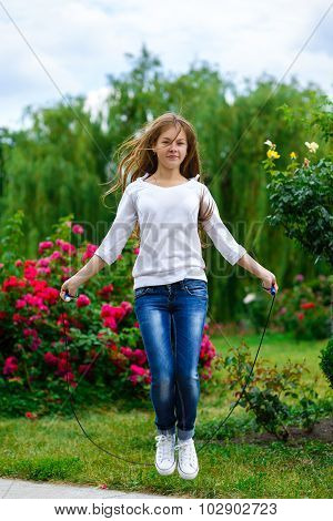 Sport and activity lifestyle concept. Cute girl jump with skipping rope