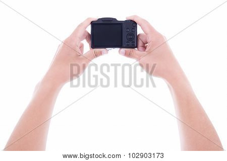 Male Hands Holding Compact Digital Camera With Blank Screen Isolated On White