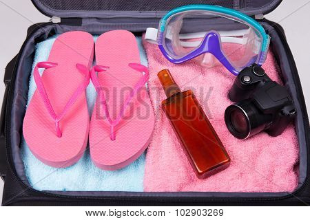 Vacation Concept - Packed Suitcase Full Of Travel Items