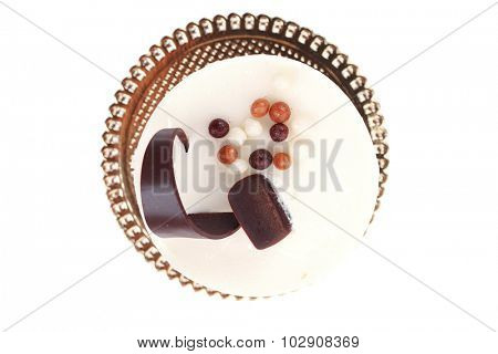 sweet pie layered chocolate milk cake with chocolate on top isolated over white background