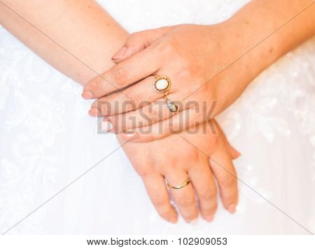 Hands of the bride with rings on fingers