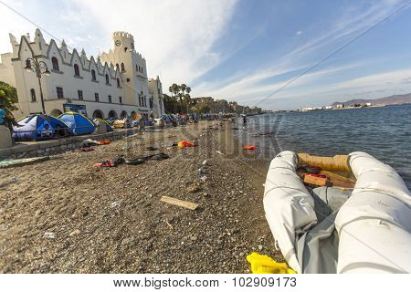 KOS, GREECE - SEP 27, 2015: Tents war refugees in the port of Kos. According to the coast guard, every day on a Greek islands can be reached from 600 to 800 refugees.