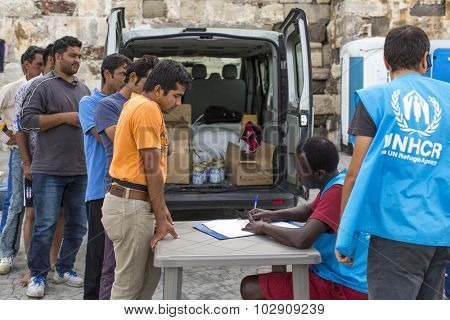 KOS, GREECE - SEP 27, 2015: War refugees are registered employees of the UNHCR. Kos island is located just 4 kilometers from the Turkish coast, and refugees come from Turkey on inflatable boats.
