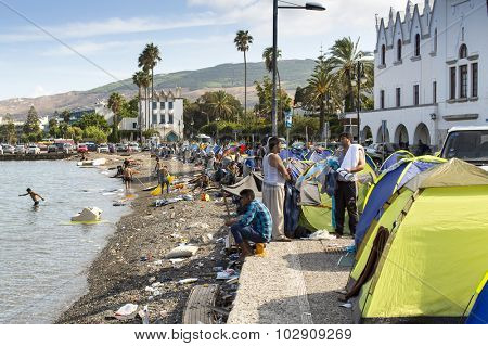 KOS, GREECE - SEP 27, 2015: Tents war refugees in the port of Kos island. According to the coast guard, every day on a Greek islands can be reached from 600 to 800 refugees.