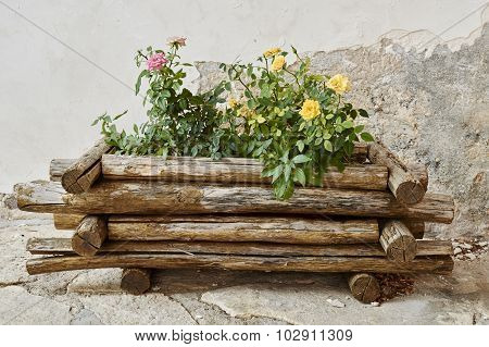 Wooden Vase With Flowers