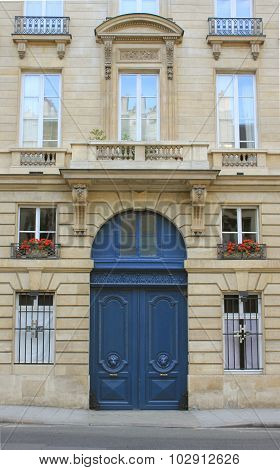 Paris street in summer, flower pots, door and windows