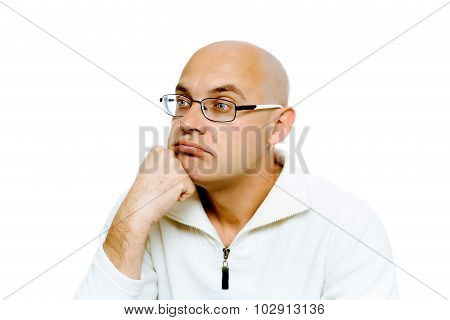 Pensive Man In Glasses. Studio. Isolated