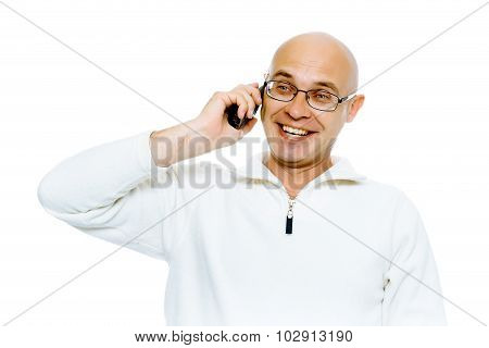 Bald Smiling Man Speaking By Phone. Studio. Isolated