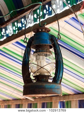 The Old Lamp Hangs On Beam Colorful Blur Background.