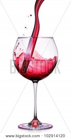 Glass of red wine with splashes isolated on a white