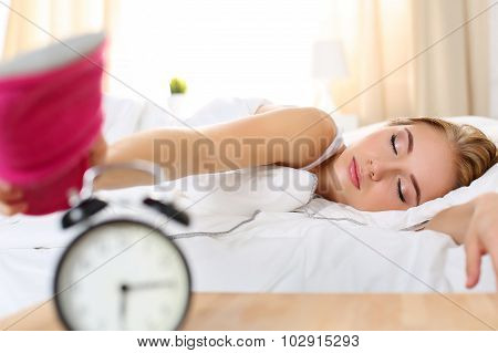 Sleepy Young Beautiful Woman Trying Kill Alarm Clock