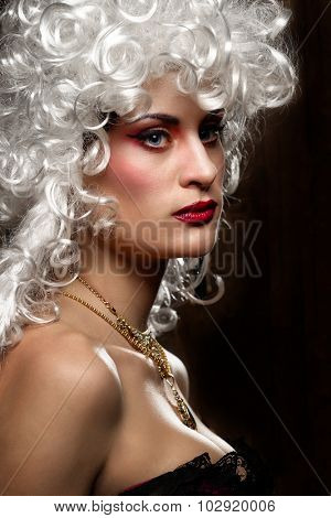 Close up of gorgeous woman in ancient style wig