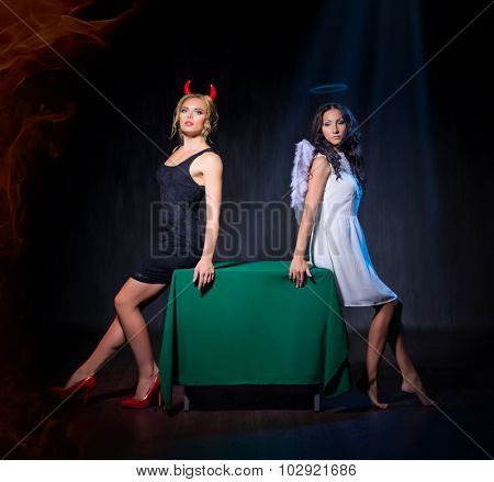 Angel and devil on table